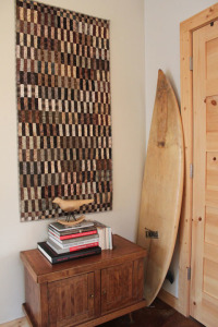 taupe hope with surfboard